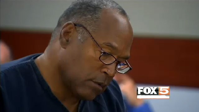 A graying O.J. Simpson jots down notes during the first day of his bid for a retrial in his 2008 conviction. (May 13, 2013/FOX5)