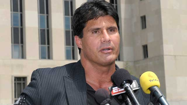 Jose Canseco talks with reporters after appearing in federal court in Washington, Thursday, June 3, 2010. (AP Photo/Susan Walsh)