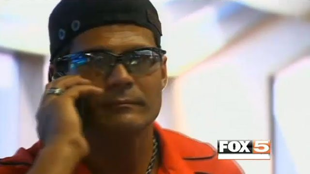Jose Canseco talks on a cell phone at an airport in Dallas on May 22, 2013.