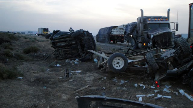 Twisted metal and overturned cars lay along Interstate 80 near Winnemucca, NV, after a 27-car pileup June 10, 2013. (Source: NV Dept. of Public Safety)