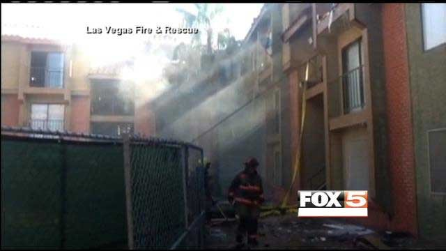 A firefighter walks through the rubble of a burned apartment building in Las Vegas. (Source: LVFR)