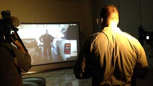 Tack Officer Fred Oliveri demonstrates a simulator used to train Las Vegas Metro police officers on June 19, 2013. (FOX5/Elizabeth Watts)