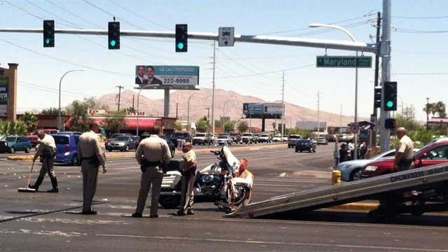 Officers work to clear the scene of a crash involving a motorcycle officer on June 20, 2013. (FOX5/Azenith Smith)