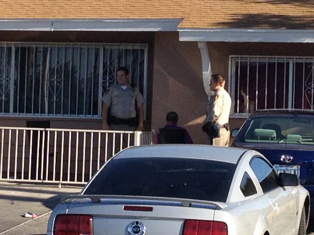 Police serve a search warrant at a Las Vegas house suspected of being a brothel. (Lindsay Curtis/FOX5)