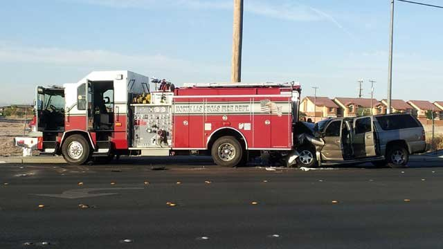 The front of an SUV is crumpled after colliding with a fire engine in Sunrise Manor on June 21, 2013. (FOX5/Armando Navarro)