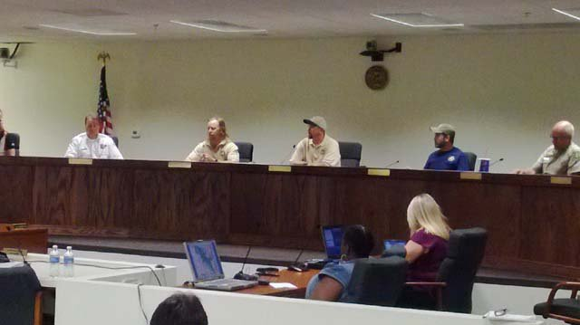 Members of the Forest Service and others answer questions. (Jon Castagnino/FOX5)
