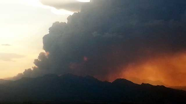 The sun sets behind a large plume of smoke rising from Mt. Charleston on July 5, 2013. (Source: FOX5 Viewer Gary)