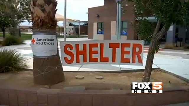 A sign directs evacuees to a shelter at a Las Vegas school on July 8, 2013. (FOX5)