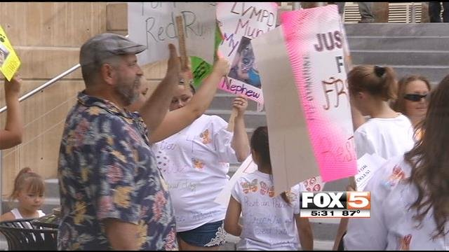 People protest Metro's killing of Freckles in front of the Regional Justice Center on Thursday. (FOX5)