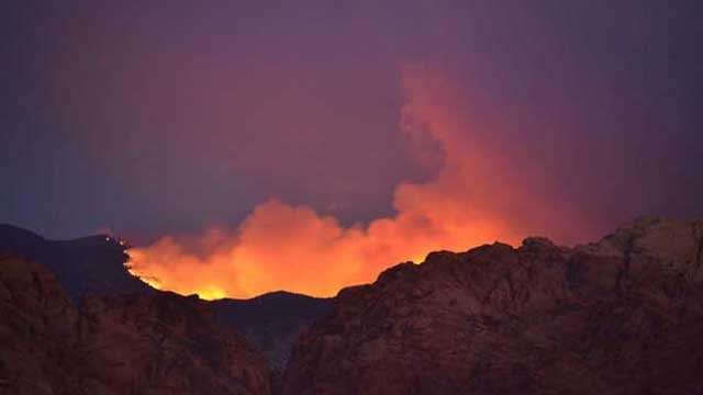 The orange glow of flames from the Carpenter 1 wildfire light up the evening sky on July 10, 2013. (Soruce: Aaron Leifheit)