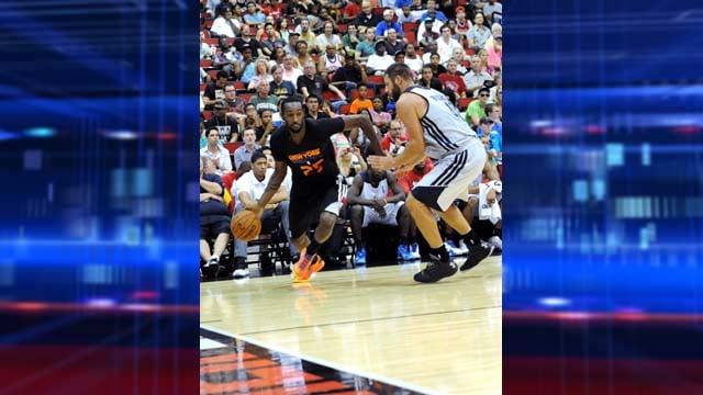 New York Knicks #25 C.J. Leslie heads to the basket past New Orleans #40 Jon Brockman. (Glenn Pinkerton/Las Vegas News Bureau)
