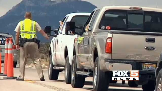 Some of the first Carpenter 1 evacuees pass through a checkpoint as they returned home on July 14, 2013. (FOX5)