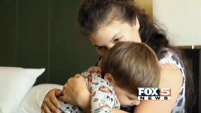 Guadalupe Howard hugs her son in their Eastside Cannery hotel room July 16, 2013, as they pack for their return to Kyle Canyon. (Lindsay Curtis/FOX5)