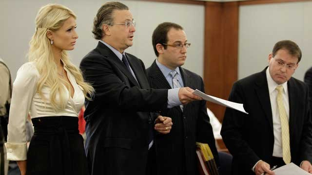 Paris Hilton, left, listens as her attorney David Chesnoff, center, shows the plea agreement to Judge Joe Bonaventure as prosecutor David Schubert, right looks on in county court Monday, Sept. 20, 2010, in Las Vegas. (AP Photo/Julie Jacobson)