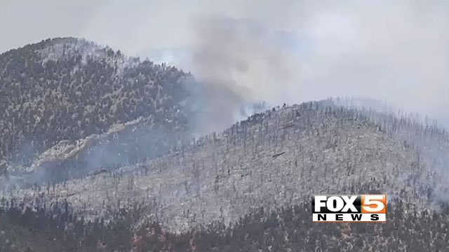 Smoke rises from the ground charred by the Carpenter 1 fire in the Spring Mountains in this July 10, 2013 image. (FOX5)