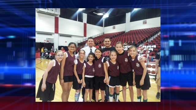 Garcia and the basketball team he coaches. (Garcia family)