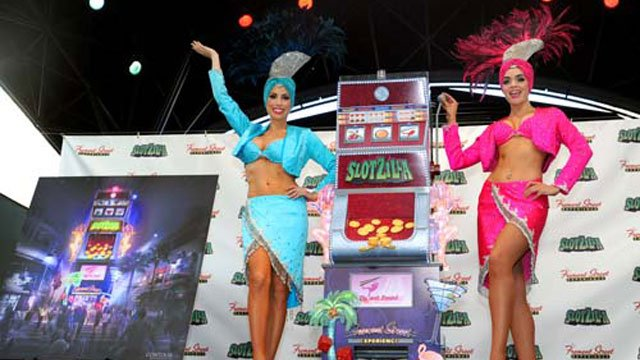Las Vegas showgirls unveil the model of SlotZilla. (Brian Jones/Las Vegas News Bureau)