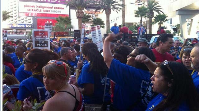 Culinary Union members picket in front of The Cosmopolitan Wednesday. (Ashley Conroy/FOX5)