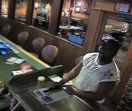 Surveillance still of a suspect in a series of robberies in the northeast. (LVMPD)