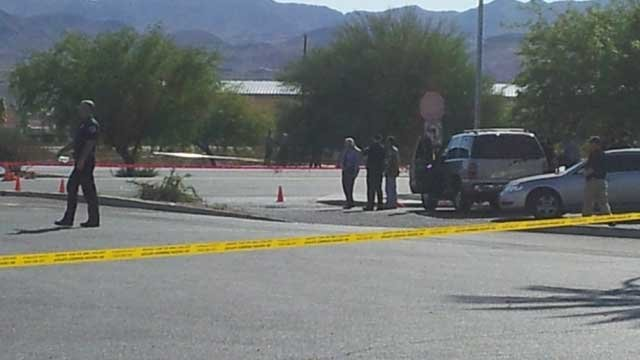 Police taped off a section of College Drive and Boulder Highway following an officer-involved shooting. (Eric Youngman/FOX5)