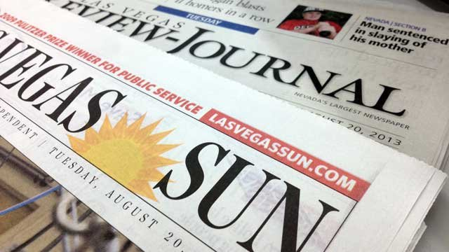 The masthead of the Las Vegas Sun and the Las Vegas Review-Journal are seen on the Aug. 20, 2013, editions. (FOX5)