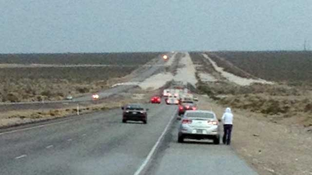 Emergency crews block off U.S. Highway 95 between Lee Canyon and Kyle Canyon roads on Aug. 25, 2013. (Source: Paul Wieczorek)