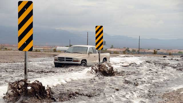 A truck is stuck in flood waters Aug. 26, 2013 near Grand Teton and Oso Blanco. (Source: Shannon Foley)