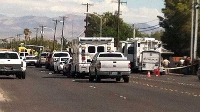 Emergency vehicles block off parts of Mountain Vista Street during a standoff on Aug. 27, 2013. (Azenith Smith/FOX5)