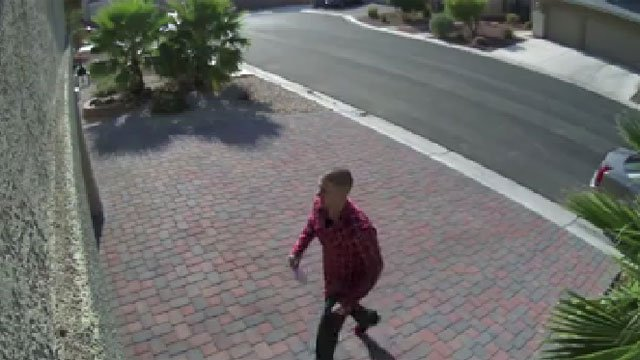 A surveillance camera at the front door of Ed Vidal's home captured the suspect of a burglary. (Ed Vidal/Facebook)