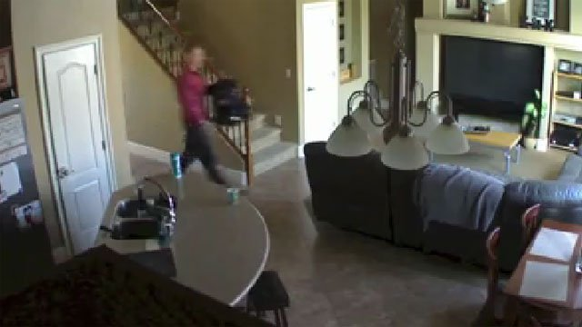 Throughout the video, the suspect is seen looking around the house and taking things out of rooms. (Ed Vidal/Facebook)
