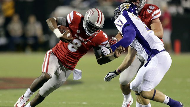 UNLV quarterback Caleb Herring (8) avoids a tackle by Western Illinois linebacker Kevin Kintzel (17) in the second quarter of an NCAA college football game on Saturday, Sept. 21, 2013, in Las Vegas. (AP Photo/Julie Jacobson)