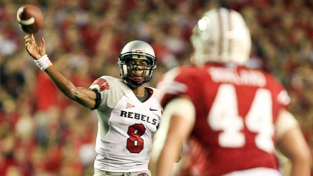 UNLV quarterback Caleb Herring (8) throws a pass as Wisconsin's Chris Borland defends during the first half of an NCAA college football game, Thursday, Sept. 1, 2011, in Madison, Wis. (AP Photo/Andy Manis)