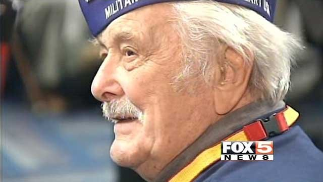 A veteran waits to a board a flight at McCarran International Airport bound for Washington on Oct. 11, 2013. (FOX5)