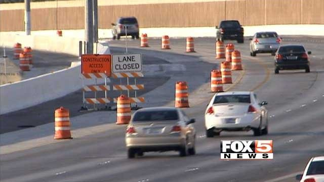 Construction barrels direct traffic out of a lane on Interstate 215 near McCarran International Airport in this undated image. (File/FOX5)