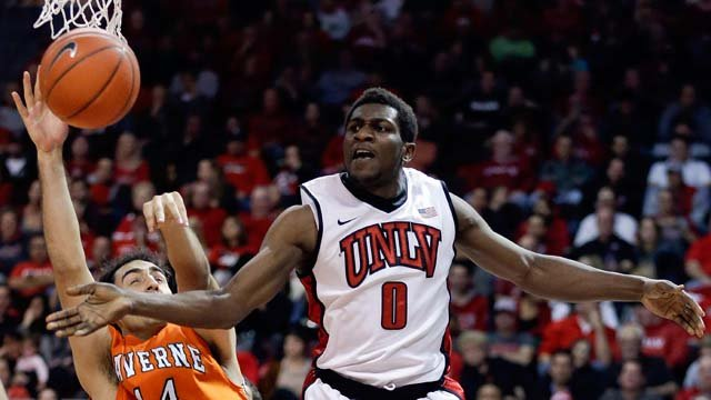 UNLV's Savon Goodman (0) passes the ball off against La Verne's Alex Wolpe in the second half of an NCAA college basketball game, Thursday, Dec. 13, 2012, in Las Vegas. (AP Photo/Julie Jacobson)