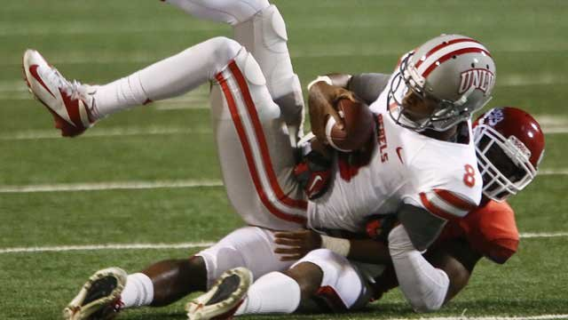 UNLV's quarterback Caleb Herring is sacked by a Fresno State's Charles Washington (28) during the first half of an NCAA college football game Saturday, Oct. 19, 2013, in Fresno, Calif. (AP Photo/Gary Kazanjian)