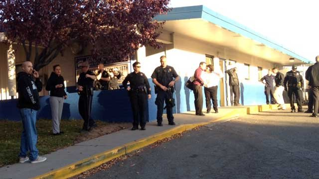 Police stand watch at Sparks Middle School after a shooting on Oct. 21, 2013. (Source: KOLO-TV)