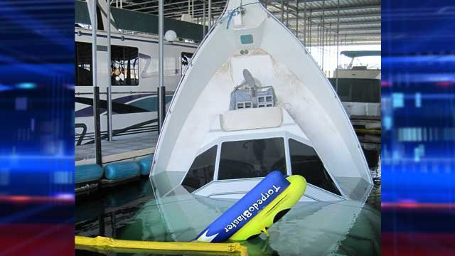 The 65-foot vessel reportedly belonging to Wayne Newton submerged in 45 feet of water at Temple Bar marina. (National Park Service)