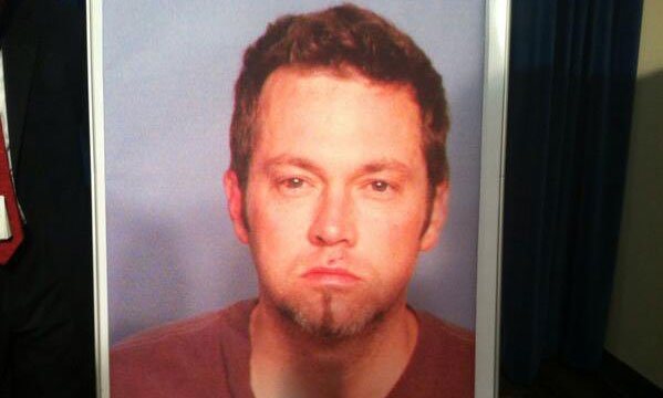 A mugshot of Benjamin Frazier is presented to the media at a news conference Oct. 21, 2013. (FOX5)