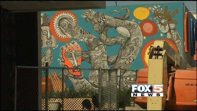 Street artists put the finishing touches on murals prepared for the Life is Beautiful festival on Friday. (FOX5)