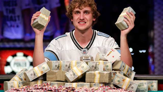 Ryan Riess holds up two bricks of $100 bills after winning the World Series of Poker Final Table, Tuesday, Nov. 5, 2013, in Las Vegas. (AP Photo/Julie Jacobson)