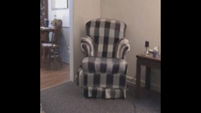 The FBI noted a plaid chair is featured prominently in the videos. (Source: FBI)