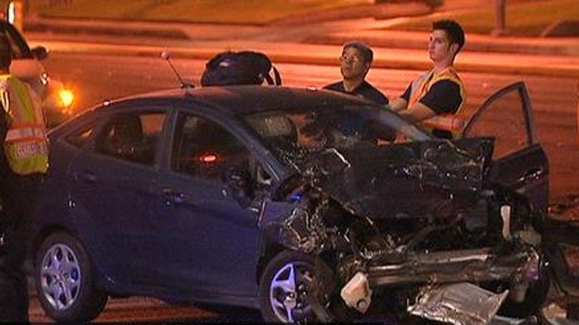 A woman was killed in a three-vehicle wreck on Warm Springs Road and Eastern Avenue on Nov. 14, 2013. (FOX5)