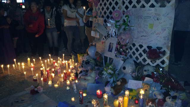 People gathered to remember 14-year-old Helen Liu, who was hit and killed by a truck on Saturday. (Jon Castagnino/FOX5)