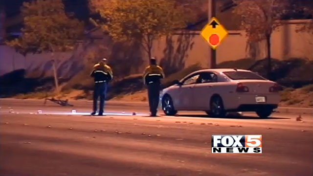 Investigators look over the scene of a crash after a boy riding his bike was hit by a car Nov. 16, 2013. (FOX5)