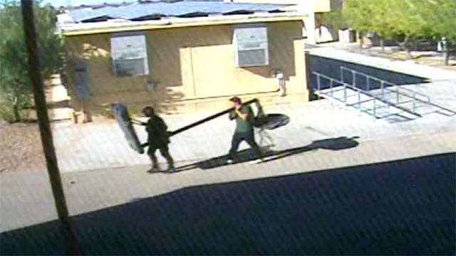 A surveillance still of two thieves stealing from the RISE Education Resource Center on Nov. 11. (Source: RISE Education Resource Center)