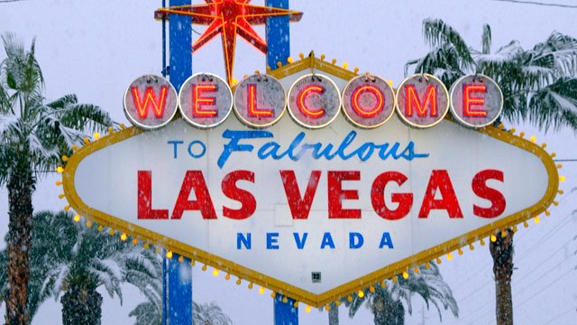 Snow falls at the iconic welcome sign on the Las Vegas Strip on Dec. 17, 2008. (AP Photo/Las Vegas News Bureau, Darrin Bush)