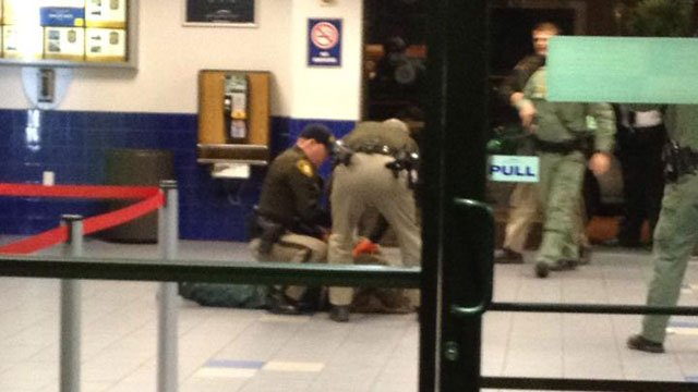 Officers were seen apprehending the suspected shooter in the Greyhound bus station shooting on Dec. 5, 2013. (Photo courtesy of FOX5 viewer Julian)