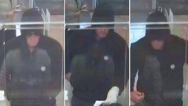 Police said a man wore a white sock on his left hand while holding up a bank teller on Dec. 7, 2013. (Henderson PD)