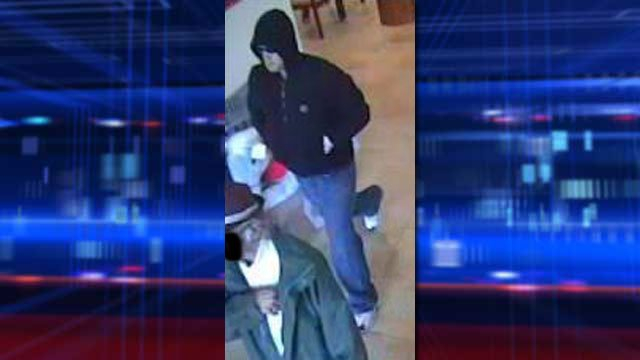 Police released an image of the hooded suspect fleeing the Wells Fargo bank branch on Dec. 7, 2013. (Henderson PD)